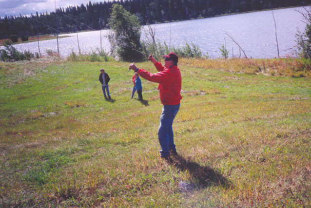 Eldon Lendon flying a kite at Bedore Lake.